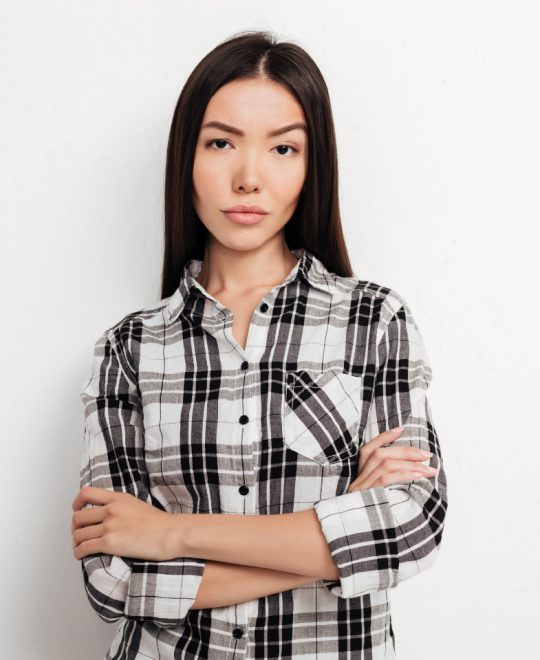 beautiful-girl-with-dark-hair-standing-and-angrily-WV4D4DW.jpg